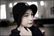 Young student at the HipHop2 (quadrate) School in Arnhem in the Netherlands. At the Hip Hop school youngsters from 10 to 25 can take workshops in rap, hip hop, breakdance and DJ Spinning...In Arnhem is sinds januari 2006 een HipHopschool gevestigd. Op deze school kunnen jongeren van tussen de 10 en 25 jaar workshops volgen in Rap, R&B zang, Breakdance, HipHop dance en DJ Spinning. Dit iniatief is tot stand gekomen door een samenwerking van Stichting Interart en de Arnhemse Rapgroep ' Andere Gekte'.  Arnhem, NETHERLANDS - 15-2-06: