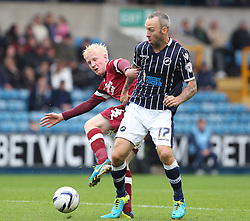 Millwall's Shaun Derry vies for possession with Derby County's Will Hughes  - Photo mandatory by-line: Robin White/JMP - Tel: Mobile: 07966 386802 14/09/2013 - SPORT - FOOTBALL -  The Den - London - Millwall V Derby County - Sky Bet League Championship