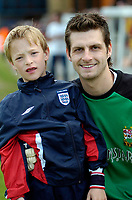 Photo: Ed Godden.<br />Barnet v Stockport County. Coca Cola League 2. 29/04/2006. Barnet keeper, Ross Flitney, pictured with a family friend at full-time.