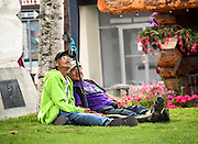 Alaskan natives enjoying a beautiful day outside the visitor center in Anchorage