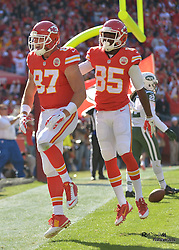 Nov 2, 2014; Kansas City, MO, USA; Kansas City Chiefs tight end Travis Kelce (87) celebrates with wide receiver Frankie Hammond (85) after Kelce scores a touchdown during the first half against the New York Jets at Arrowhead Stadium. The Chiefs won 24-10. Mandatory Credit: Denny Medley-USA TODAY Sports