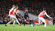 Dinamo Zagreb's Marko Pjaca in a rare attac but surrounded by 3 Arsenal players during the Champions League match between Arsenal and Dinamo Zagreb at the Emirates Stadium, London, England on 24 November 2015. Photo by Matthew Redman.