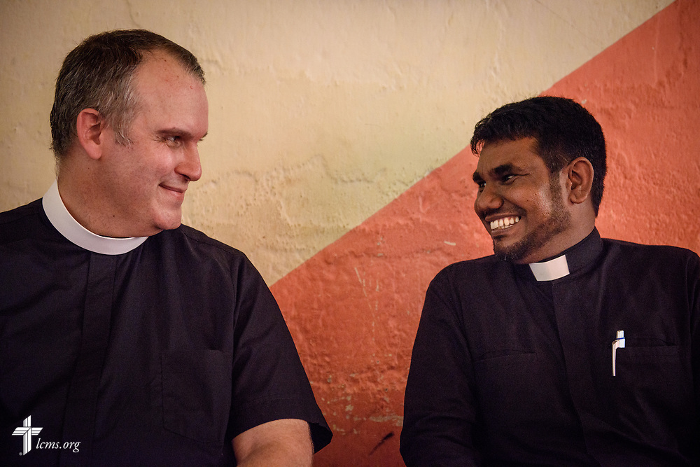 The Rev. Steven Mahlburg, LCMS career missionary to Sri Lanka, shares a moment with the Rev. P. Gnanakumar, as the two visit Gnanakumar's church members on the Eila rubber plantation in the Sabaragamuwa Province of Sri Lanka on Saturday, Jan. 20, 2018. LCMS Communications/Erik M. Lunsford