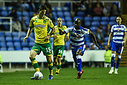 Norwich City Defender, Timm Klose (15) beats Reading Forward, Sone Aluko (14) to the ball during the EFL Sky Bet Championship match between Reading and Norwich City at the Madejski Stadium, Reading, England on 19 September 2018.