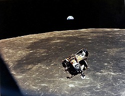 In Lunar Orbit - (FILE) -- With a half-Earth in the background, the Lunar Module (LM) ascent stage with Moon-walking Astronauts Neil Armstrong and Edwin Aldrin Jr. aboard approaches for a rendezvous with the Apollo Command Module manned by Michael Collins on Monday, July 21, 1969. The Apollo 11 liftoff from the Moon came early, ending a 22-hour stay on the Moon by Armstrong and Aldrin..Photo by CNP/ABACAPRESS.COM