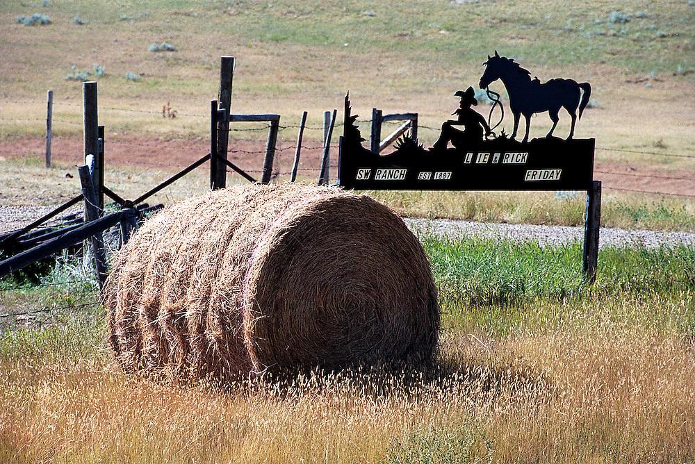 Bale and metal ranch sign in southwest Saskatchewan