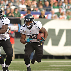 Nov 15, 2009; East Rutherford, NJ, USA; Jacksonville Jaguars running back Maurice Jones-Drew (32) runs through a hole during first half NFL action between the New York Jets and Jacksonville Jaguars at Giants Stadium.