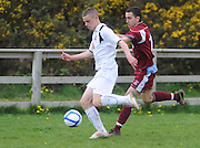 Pierce Donnachie, Cobh Ramblers chasing Garry Kelly, Galway United in  Cappa Park in Knocknacarra, Galway. Photo:Andrew Downes.