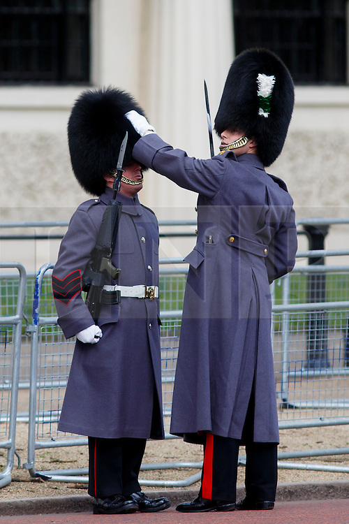 © Licensed to London News Pictures. 03/03/2015. LONDON, UK. Guards preparing as they guard the Mall during Mexican President's state visit in central London on Tuesday, 3 March 2015. Photo credit : Tolga Akmen/LNP