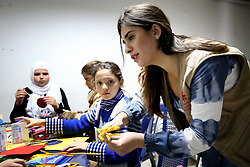 Psychologist Lina Zaarour runs an art therapy class for Syrian refugee children at a Caritas centre in the Bekaa Valley region of Lebanon. The classes form part of the psychological care given to the children to help them overcome the trauma of war using arts, crafts and games.