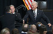 Vice President Joe Biden shakes hands with a member of the audience as he takes questions after a speech at Iowa State University in Ames, Iowa on Thursday, March 1, 2012.