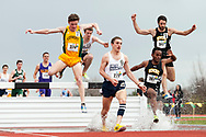 UVM's Aaron Anderstrom leaps over the water hazard during the 3000 meter steeplechase during the first day of the America East Track and Field Championship at the Frank H. Livak Track and Field Facility on Saturday May 3, 2014 in Burlington, Vermont. (BRIAN JENKINS, for the Free Press)