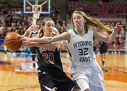 Wyoming East guard Gabby Lupardus (32) blocks the shot of Bluefield guard Alyssa Lester (20) during a first round game at the Charleston Civic Center.