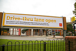 "© Licensed to London News Pictures. 04/06/2020. London, UK. A ""DRIVE THRU LANE OPEN' banner displayed outside McDonald's Drive Thru in north London. McDonald's Drive Thru opens in Haringey after lockdown restrictions are relaxed. Photo credit: Dinendra Haria/LNP"