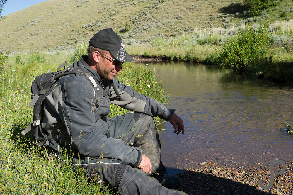 Shannon Markle from Laramie WY waits for other riders to show up at the low water crossing.