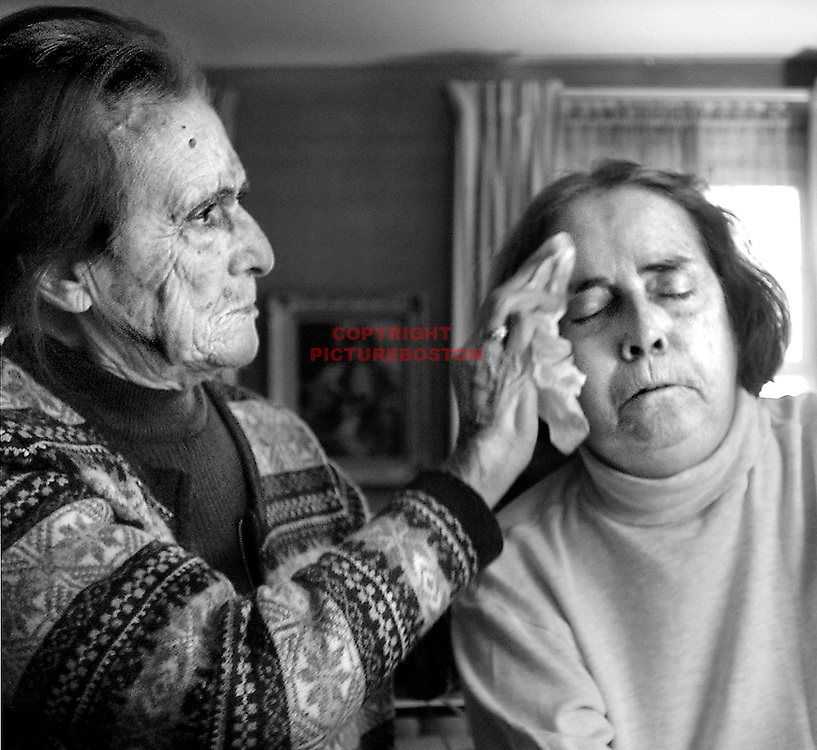 """Choosing Hospice""  - Ann O'Neill wipes moisture from the face of her daughter Maureen O'Neill. The next day Maureen would be gone.  fragm."