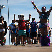 May 17, 2013 - Queens, NY :  Concertgoers walk down the boardwalk leading from the Long Island Railroad, as they approach Citi Field at the start of the first day of the 2013 New York 'Electric Daisy Carnival,' an electronic dance music festival, at Citi Field in Queens, on Friday afternoon. CREDIT: Karsten Moran for The New York Times CREDIT: Karsten Moran for The New York Times