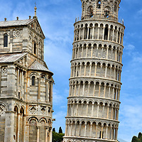 Leaning Tower of Pisa and Duomo in Pisa, Italy <br /> The Leaning Tower of Pisa was built from 1173 to 1372 as a freestanding bell tower behind the Pisa Cathedral, a portion of which is on the left.  From this angle you can see how much the tower still tilts despite the 1990 through 2001 restoration that corrected it to within four degrees.  But this could also be partially an optical illusion because the Duomo is also leaning.