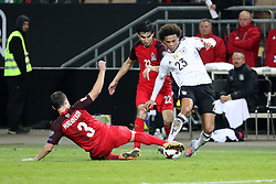 KAISERSLAUTERN, Oct. 9, 2017  Magomed  Mirzabekov (L) of Azerbaijan and Leroy Sane (R) of Germany vie for the ball during the FIFA 2018 World Cup Qualifiers Group C match between Germany and Azerbaijan at Fritz Walter Stadium in Kaiserslautern, Germany, on Oct. 8, 2017. Germany won 5-1. (Credit Image: © Ulrich Hufnagel/Xinhua via ZUMA Wire)
