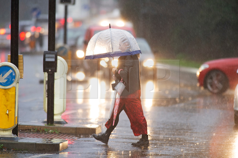 ©Licensed to London News Pictures 09/01/2020<br /> Orpington ,UK Wet weather for this parent in Orpington, Kent as she walks to school to collect her children with spare umbrellas in hand. Heavy rain this afternoon as The Met Office has warned that downpours and strong winds will make driving conditions difficult. Photo credit: Grant Falvey/LNP