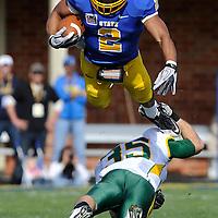 South Dakota State Univeristy's Tyrel Kool leaps over North Dakota State University's Christian Dudzik during their game at the Coughlin-Alumni Stadium in Brookings, S.D. NDSU won 38-14.