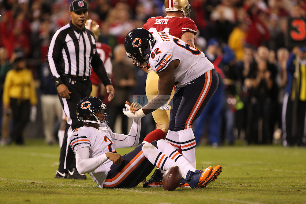 San Francisco 49ers defensive tackle Justin Smith (94) and linebacker Aldon Smith (99) sack Chicago Bears quarterback Jason Campbell (2), during an NFL game on Monday Nov. 19, 2012 in San Francisco, CA.  (photo by Jed Jacobsohn)