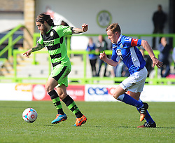 Macclesfield Town's Paul Turnbull chases after Forest Green Rovers's Rob Sinclair for the ball. - Photo mandatory by-line: Nizaam Jones - Mobile: 07966 386802 - 11/04/2015 - SPORT - Football - Nailsworth - The New Lawn - Forest Green Rovers v Macclesfield Town - Vanarama Football Conference
