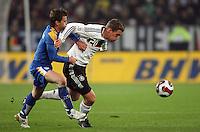 Fussball      EM Qualifikation    17.11.07 Deutschland - Zypern Lukas PODOLSKI (re, GER) im Zweikampf mit Georgios THEODOTOU (li, ZYP).