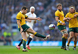 Bernard Foley of Australia puts boot to ball - Photo mandatory by-line: Patrick Khachfe/JMP - Mobile: 07966 386802 29/11/2014 - SPORT - RUGBY UNION - London - Twickenham Stadium - England v Australia - QBE Internationals