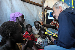 EU Commissioner CHRISTOS STYLIANIDES speaks to a famiy of South Sudanese refugees. During his trip, the Commissioner went to BidiBidi settlement in Northern Uganda, now the third largest refugee settlement in the world. It currently holds more than 210,000 South Sudanese refugees escaping from war, and the ongoing influx of a daily average of 3,000 refugees is causing a strain on humanitarian aid and funding.