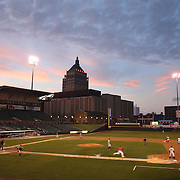 A panoramic view of Frontier Field at sunset showing the Kodak building in the background during the Rochester Red Wings V The Scranton/Wilkes-Barre RailRiders, Minor League ball game at Frontier Field, Rochester, New York State. USA. 16th April 2013. Photo Tim Clayton