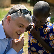 Kevin Brennan, Rep. Rosa DeLauro's Chief of Staff talks with children in Siaya district during the Kenya Learning Tours delegation visit to the region.