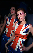 A man and a woman wearing rubber Union Jack tops in a club Croatia 1990's