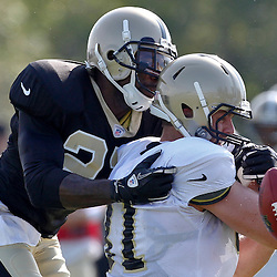 July 29, 2012; Metairie, LA, USA; New Orleans Saints safety Malcolm Jenkins (27) breaks up a pass intended for tight end Mike Higgins (81) during a training camp practice at the team's practice facility. Mandatory Credit: Derick E. Hingle-US PRESSWIRE