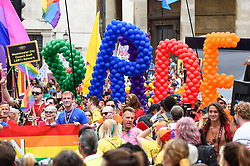 © Licensed to London News Pictures. 06/07/2019. LONDON, UK. Balloons spell PRIDE at the head of the parade. Tens of thousands of visitors, many wearing eye-catching costumes, gather to watch and take part in the annual Pride in London Parade, the largest celebration of the LGBT+ community in the UK.  This year's event also celebrates 50 years since the birth of the modern LGBT+ rights movement. Photo credit: Stephen Chung/LNP