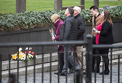 © Licensed to London News Pictures. 22/03/2018. London, UK. A group of people lay flowers at the scene where PC Keith Palmer died, at New Palace Yard, inside the grounds of the Houses of Parliament in Westminster, London on the one year anniversary of the Westminster Bridge Terror attack. A lone terrorist killed 5 people and injured several more, in an attack using a car and a knife. The attacker, 52-year-old Briton Khalid Masood, managed to gain entry to the grounds of the Houses of Parliament and killed police officer Keith Palmer. Photo credit: Ben Cawthra/LNP