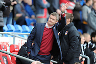 Cardiff city manager Ole Gunnar Solskjaer waves to the home crowd before k/o.  Barclays Premier league, Cardiff city v Hull city match at the Cardiff city Stadium in Cardiff, South Wales on Saturday 22nd Feb 2014.<br /> pic by Andrew Orchard, Andrew Orchard sports photography.