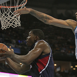05 November 2008:  Atlanta Hawks guard Joe Johnson (2) drives past New Orleans Hornets center Tyson Chandler (6) during the first half of a NBA game between the New Orleans Hornets and the Atlanta Hawks at the New Orleans Arena in New Orleans, LA..