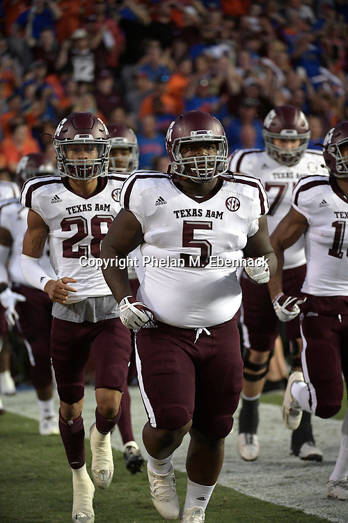 Texas A&M defensive lineman Daylon Mack (5) runs onto the field before an NCAA college football game against Florida Saturday, Oct. 14, 2017, in Gainesville, Fla. (Photo by Phelan M. Ebenhack)