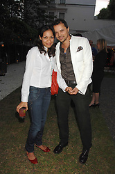Actress ROSARIO DAWSON and GERRY DEVEAUX at a party to celebrate Le Touessrok a luxury resort in Mauritius, held at The Hempel, 31-35 Craven Hill Gardens, London W2 on 12th June 2007.<br />