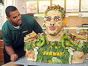 Anthony Barr, 2014 draft prospect and newest SUBWAY Famous Fan, unveils a life-size food statue made of fresh vegetables, Wednesday, May 7, 2014, in New York. Barr joins a roster of fellow Famous Fans that include Robert Griffin III, Justin Tuck, Russell Westbrook, Pele and Michael Phelps. (Photo by Diane Bondareff/Invision for SUBWAY/AP Images)