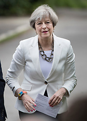 © Licensed to London News Pictures. 08/06/2017. Sonning, UK. Prime Minister Theresa May carries her polling card as she arrives at her local polling station to cast vote in the general election. Polling stations are open from 7am - 10pm.  Photo credit: Peter Macdiarmid/LNP