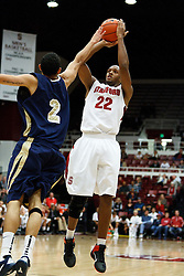 November 10, 2010; Stanford, CA, USA;  Stanford Cardinal guard Jarrett Mann (22) shoots over Cal State Monterey Bay Otters forward Derrick Anderson (2) during the first half at Maples Pavilion.