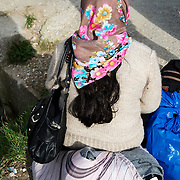 Greece with Doctors of the World (Medecins du monde). Lesvos. Moria camp for refugees in transit from Turkey to Greece. Waiting for a bus to the ferry.