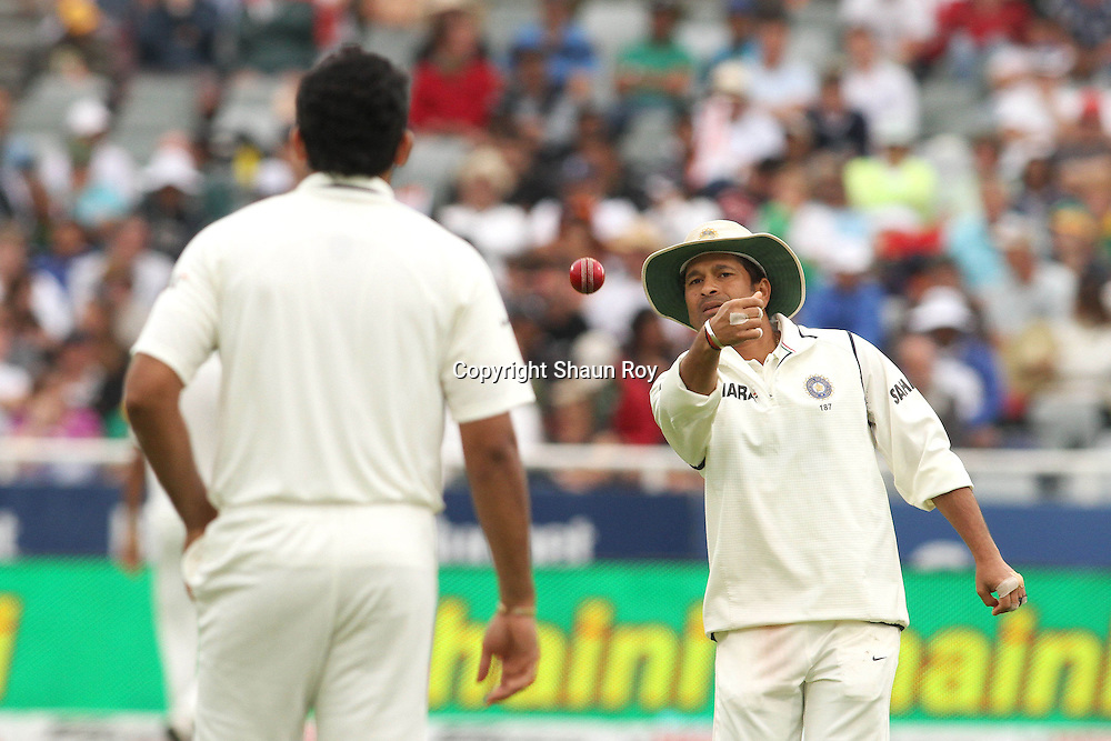 CAPE TOWN, SOUTH AFRICA - 2 January 2011, Sachin Tendulkar of India throws the ball to Zaheer Khan of India  during day 1 of the 3rd Castle Test between South Africa and India held at Sahara Park Newlands Stadium in Cape Town, South Africa on the 2 January 2011 .Photo by: Shaun Roy