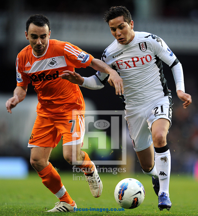 Picture by Andrew Timms/Focus Images Ltd. 07917 236526.17/03/12.Kerim Frei of Fulham and Leon Britton of Swansea City during the Barclays Premier League match at Craven Cottage stadium, London.
