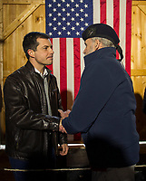 Mayor Pete Buttigieg shakes hands with Paul Tierney of New Hampton during his 2020 Barn Party on Saturday afternoon.  (Karen Bobotas/for the Laconia Daily Sun)