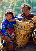 A mother & daughter awaiting a bus to take them to the local market ,  Nepal