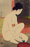 Woman after Bath, 1920. Hashiguchi Goyo (1880-1921) Japanese Ukiyo-e artist. Nude woman, half kneeling, squeezing blue and white cloth over bowl.