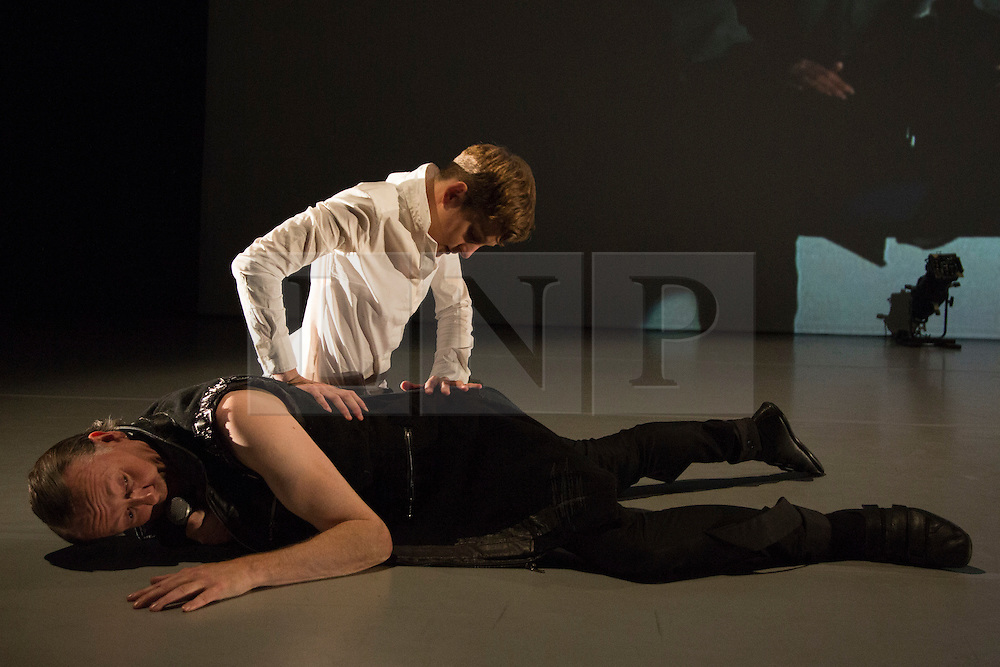 """© Licensed to London News Pictures. 09/10/2015. London, UK. Pictured: Marlieke Burghouts and Michael Turinsky performing. Robin Dingemans & Nick Bryson's """"The Point At Which It Last Made Sense"""" is performed at the Lilian Baylis Studio at Sadler's Wells on 9 October 2015. Performers: Nick Bryson, Michael Turinsky and Marlieke Burghouts. Photo credit: Bettina Strenske/LNP"""